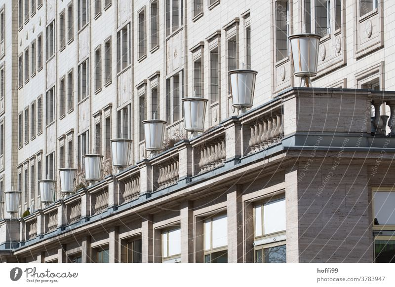 Lamp row and facade in diagonal view of a building of socialist classicism Classicism Facade row of lamps socialist urbanism Socialism Berlin Capital city