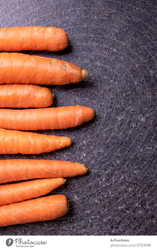 Carrots or carrots on kitchen plate Vegetable yellow beet Vegetarian diet Food Healthy Organic produce Fresh Healthy Eating Nutrition Vegan diet cake