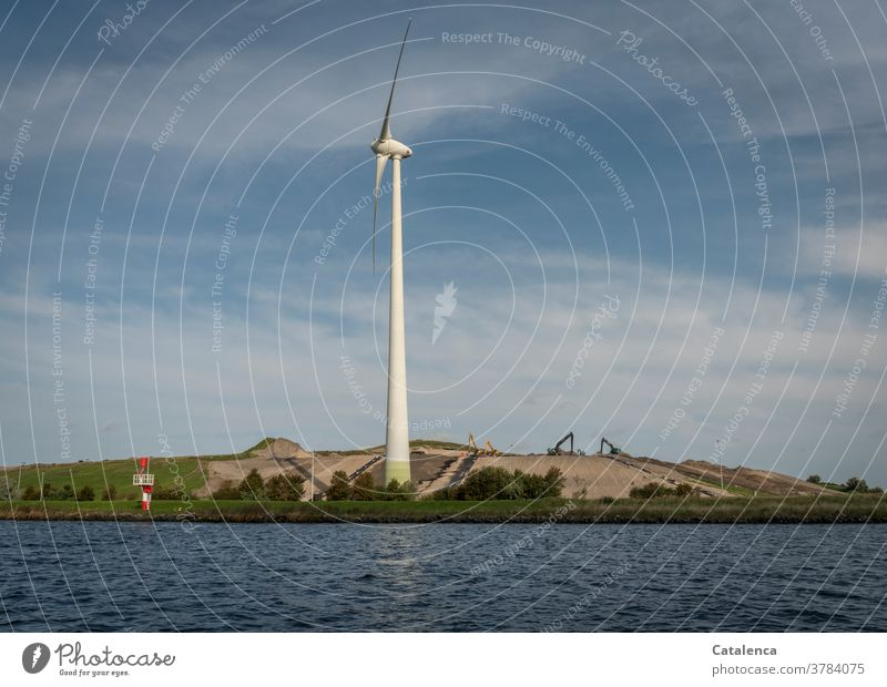 Wind turbine and construction site at the North Sea Canal Clouds Sky Channel Sustainability wind power Renewable energy shipping Water Wet Pinwheel Excavator