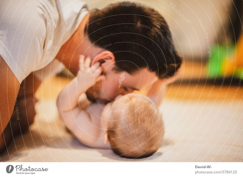 Cuddling baby and parent Baby cuddle Love Father Parents Playing Together Happy Child Happiness proximity Affection