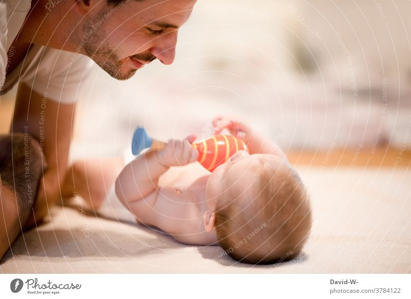 Father plays with his baby Baby Child Playing Love Together Toys Affection Emotions Son