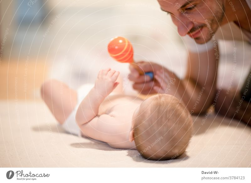 Father plays with his baby Love Playing Father with child fun Son Baby proximity Parents Together Euphoria Safety (feeling of) Happy dad Joy Happiness