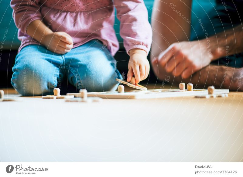 Father and child play a game together Child in common at the same time Study tutorial Infancy Parents Together Success dad Family
