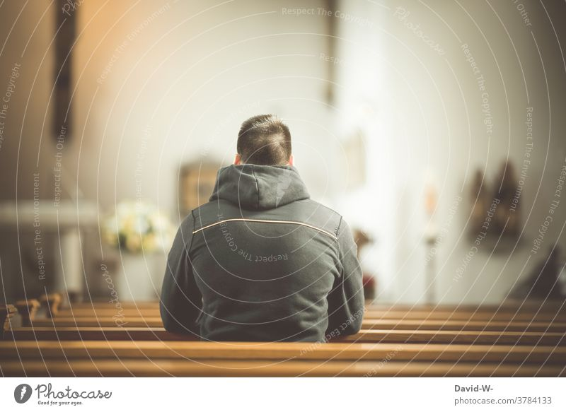 Man sits in a pew in church and prays Belief Church Church pew religion Hope Prayer praying believe Anonymous