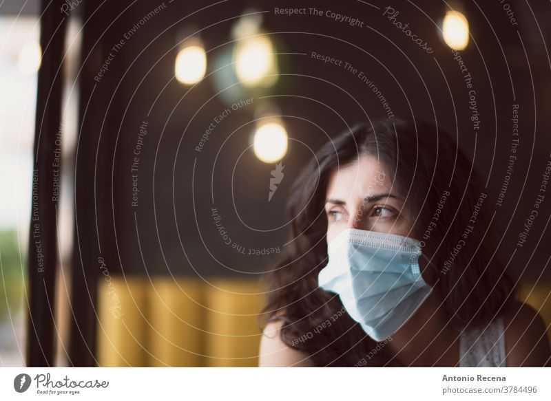 Woman portrait with surgical mask face covid-19 coronavirus pollution allergy person people one person protective corona virus mid adult 30s 30-35 years