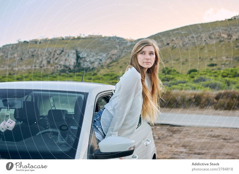 Delighted female traveler out of car window woman enjoy carefree wanderlust automobile summer nature vacation evening rest adventure happy relax driver trip
