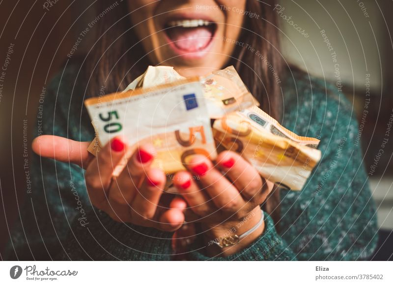 A woman holds a lot of money in her hand and is visibly happy about it. Wealth, success, profit. Money Luxury Bank note Many Joy Loose change Euro Success