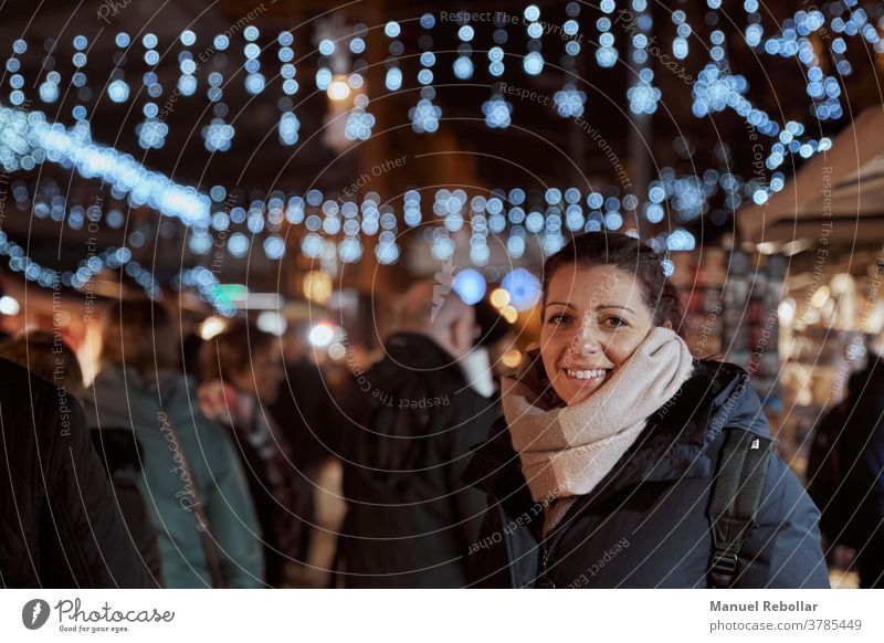 photography of a woman at christmas happy beautiful girl holiday year new winter young female xmas people celebration happiness gift red smile caucasian beauty