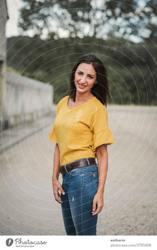 smiling young woman standing on the street beautiful elegant urban emotive gesturing natural casual expression people fashion lifestyle beauty stylish smile