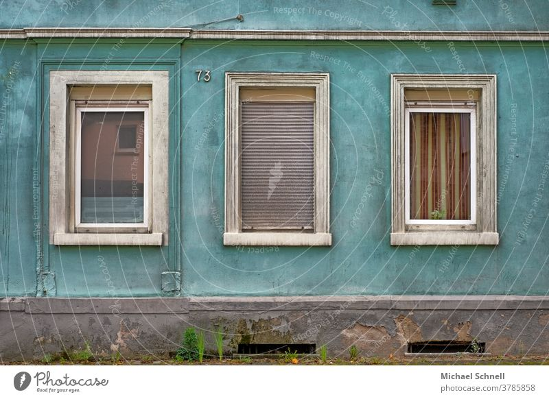 Triste house wall of an old house with three windows, one of them with closed shutters Wall (building) Facade Wall (barrier) Deserted Exterior shot Colour photo