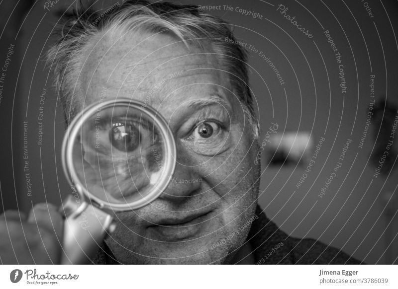 older man looks through magnifying glass Man Magnifying glass Enlarged Eyes Looking Lens Glass Investigate Search Human being Detective Curiosity Observe