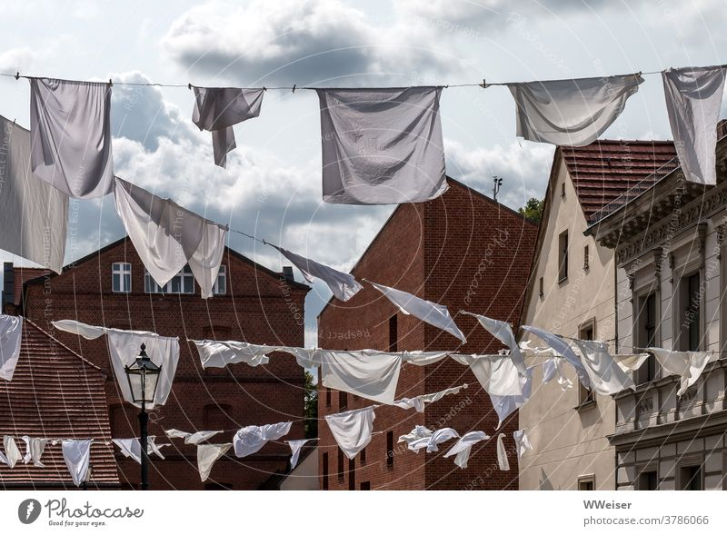 Kiezfest: The white laundry flutters in the wind Laundry clothesline Wind Sunlight Judder hung Old town köpenick Berlin lanes streets Lantern Tradition