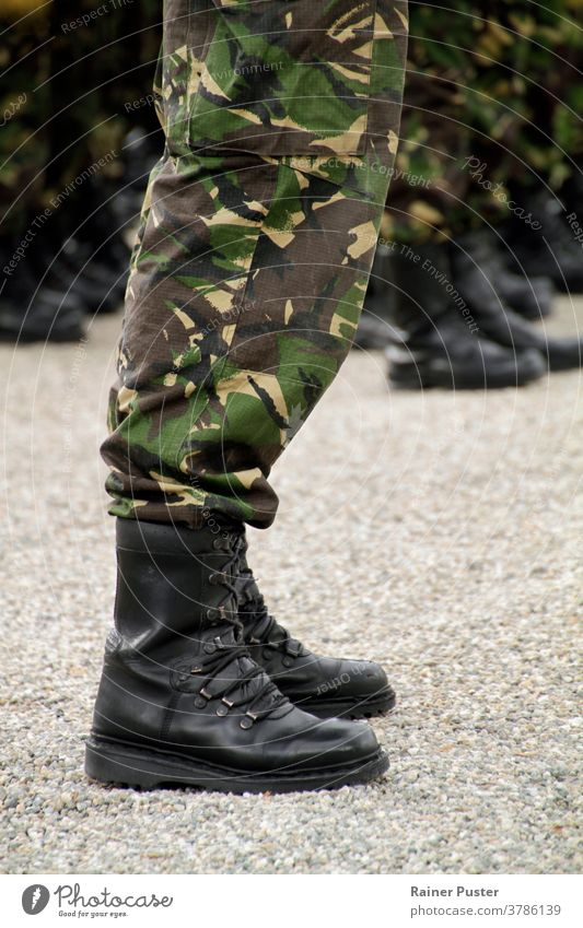 Soliders standing in a row at a military parade army camouflage closeup equipment guard gun machine gun man marching order outdoor outfit people professional