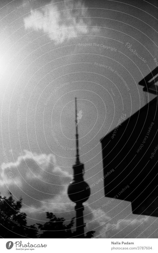 TV tower slightly sloping and building part on the right Analog analog photography Analogue photo Television tower Clouds leaves Sky Exterior shot