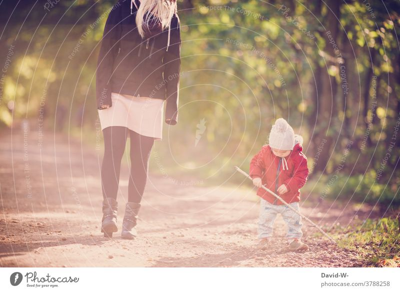 Mother and child taking an autumnal walk Family Child mama Son To go for a walk Forest Autumnal at the same time Love in common Playing Stick Parents Toddler