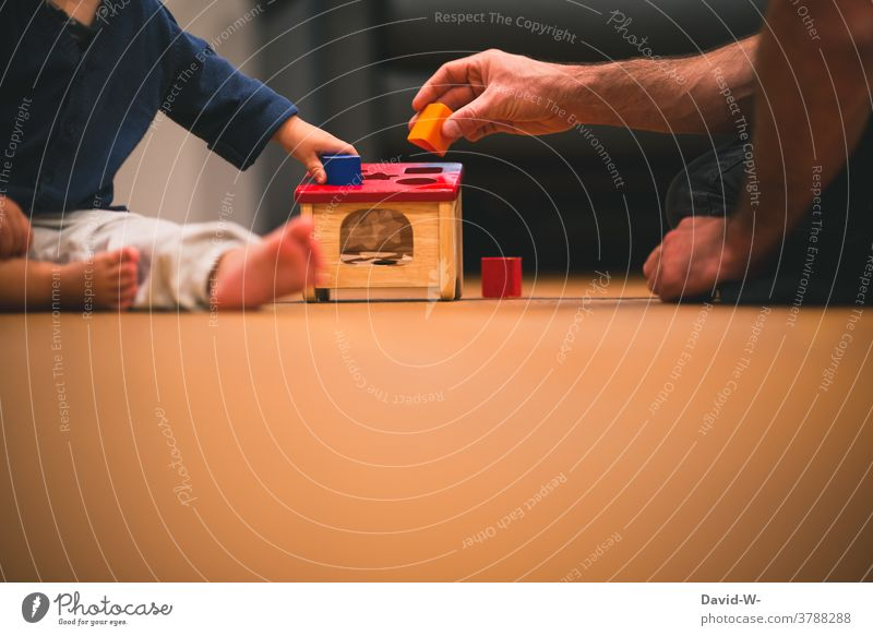 Father and child play together with building blocks and develop motor skills Development motor function Child Playing Toys at the same time Love proximity