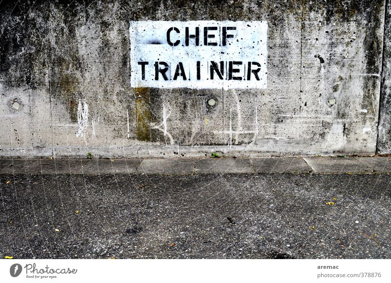 standoffish Wall (barrier) Wall (building) Traffic infrastructure Concrete Sign Characters Signs and labeling Retro Gray Coach cheftrainer Colour photo