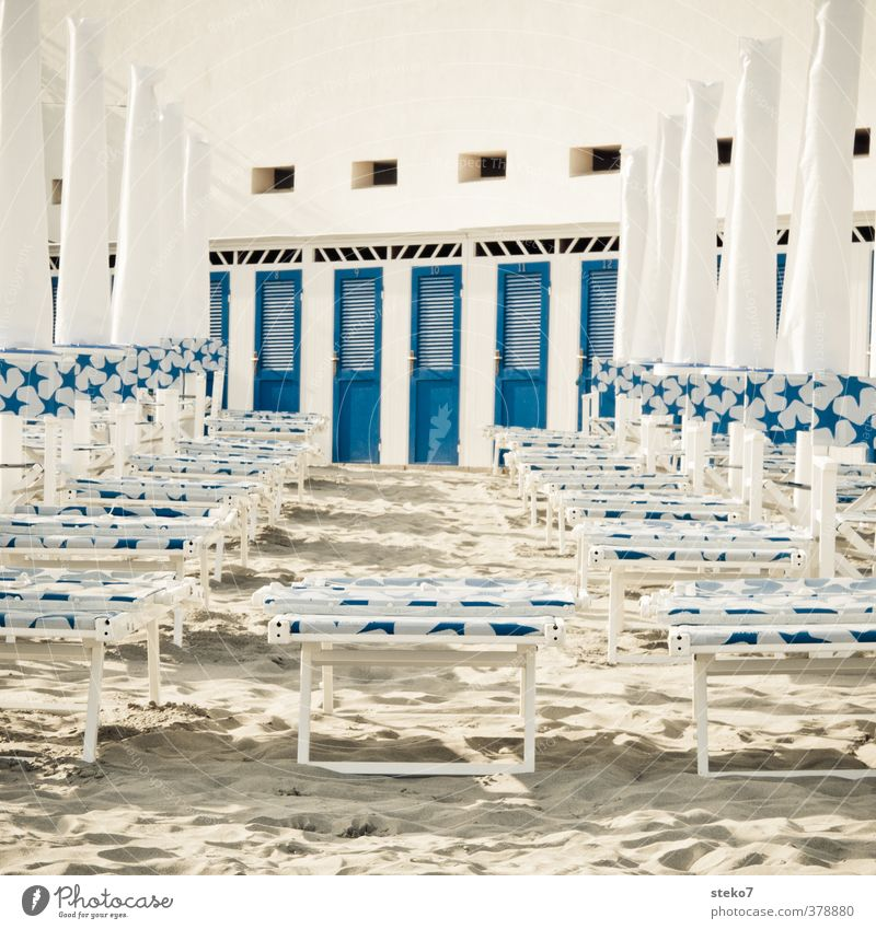 beach ghetto Tourism Summer vacation Sand Beach Clean Blue White Changing room Sunshade Deckchair Coast Subdued colour Exterior shot Deserted