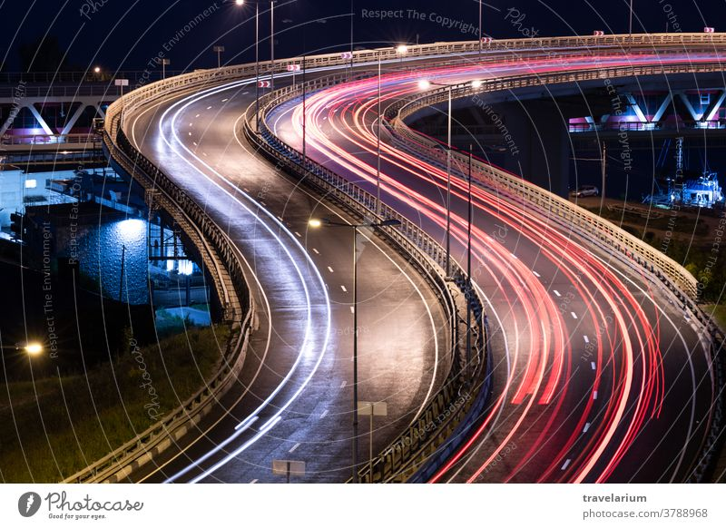 Road car light streaks. Night light painting stripes. Long exposure photography. road interchange night bridge way path speed long line trail motion background