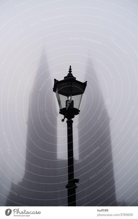 Street lamp in front of the fog-covered cathedral of Bremen Fog Misty atmosphere Shroud of fog Street lighting Dome Cathedral of Bremen Autumn autumn fog