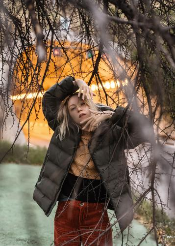 Portrait of a blonde woman autumn, with a tunnel in the background. Autumn winter warm Winter Tunnel Tree Nature Contrast raincoat color cinematic Light