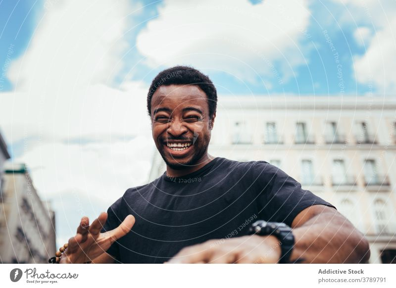 Happy black man posing on city environment happy portrait african people american male person guy adult expression background one laughing confidence face cool