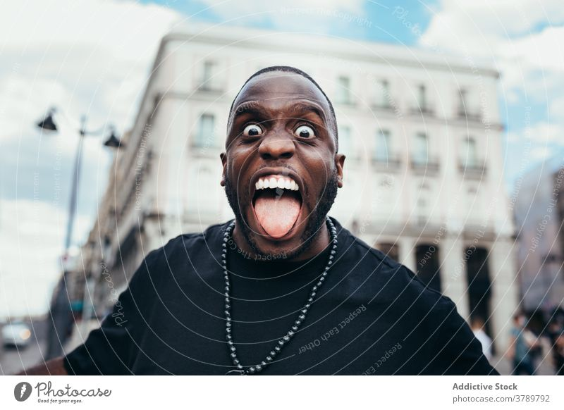 Portrait of funny black shouting at camera man male urban person portrait american adult african face people handsome young casual confident modern attractive