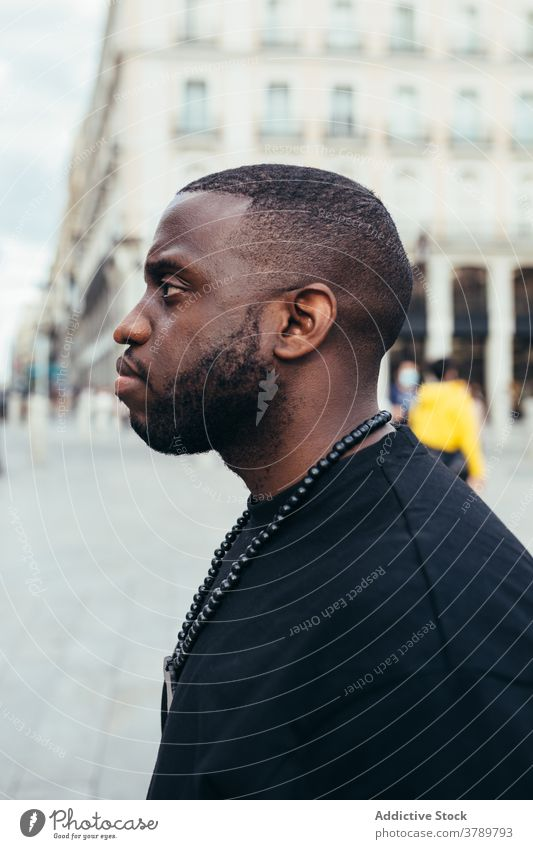 Portrait of serious black man looking away male urban person portrait american adult african face people handsome young casual confident modern attractive city