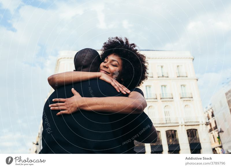 Happy african american couple hugging city love people relationship embracing happiness young happy woman two boyfriend romance together outdoors romantic