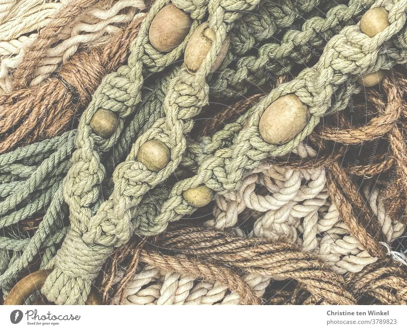 View from above on several parts macramé with wooden balls Macramé Lichen knot ropes tapes String Pattern Rope hobby Knot natural-coloured Handcrafts Green