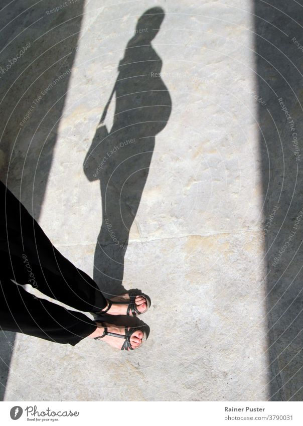 Shadow of a pregnant woman baby belly concept family feet female foot girl happiness home leg life lovely motherhood person pregnancy pregnant belly