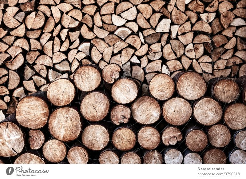 Stacking and storage of firewood Wood background Firewood Stack of wood self-sufficient Sustainability Energy Heat heating costs fuel Material structure texture