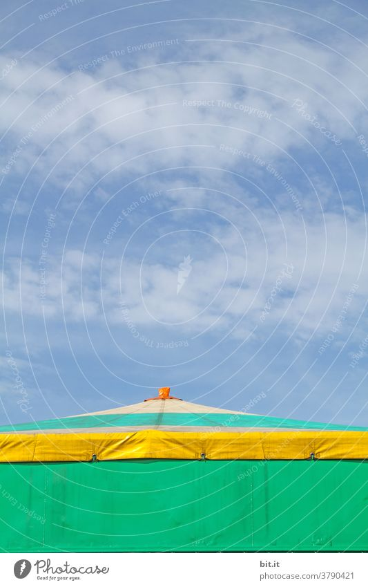 Colourful roof of the circus tent, in front of a blue sky. Circus Circus tent Tent Tarpaulin Roof tent roof copyspace copy space Copy Space Sky Blue sky Clouds