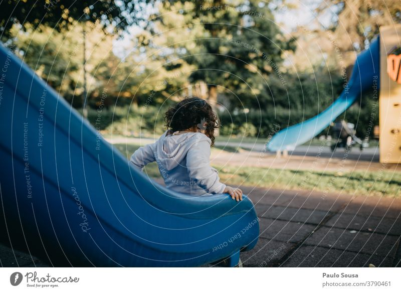 Girl playing on slide Playground Slide Kindergarten Park Colour photo Leisure and hobbies Child Day Infancy Joy Playing Exterior shot 1 - 3 years Multicoloured