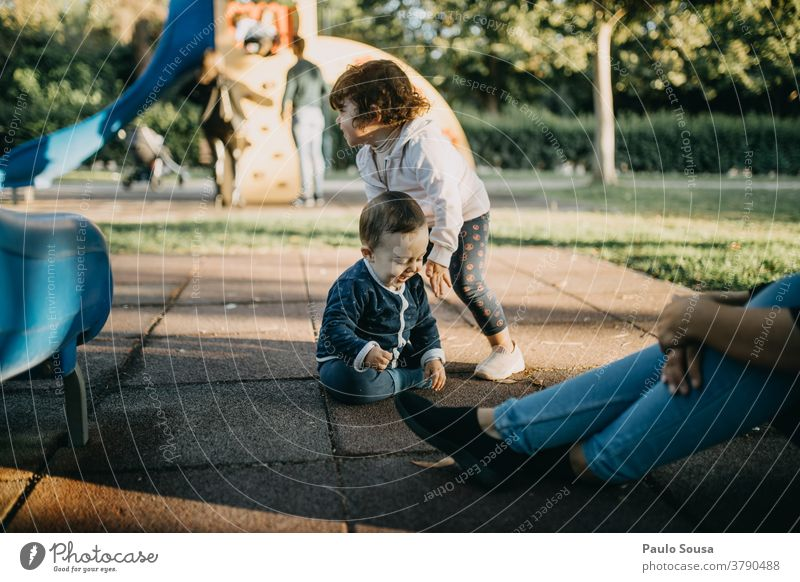 Brother and sister playing in the playground Brothers and sisters Family & Relations Playing Caucasian Friendship Lifestyle 2 Happiness Exterior shot Infancy