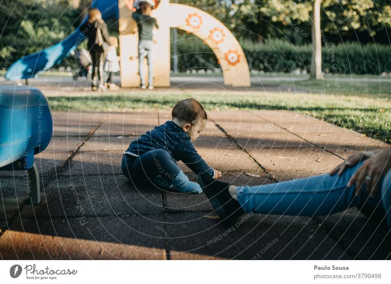 Toddler playing on playground Child childhood Children's game Playground Playing outdoors Caucasian 1 - 3 years Lifestyle Happy Happiness Leisure and hobbies