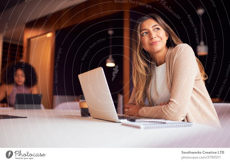 Businesswoman With Laptop At Socially Distanced Meeting In Office During Health Pandemic business businesswomen meeting social distancing socially distanced