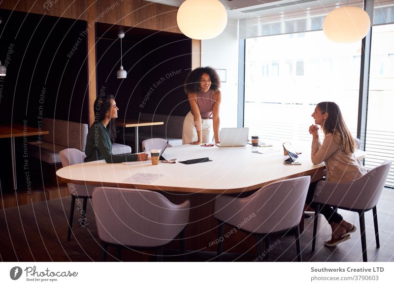 Three Businesswomen Having Socially Distanced Meeting In Office During Health Pandemic business women in business businesswomen meeting social distancing