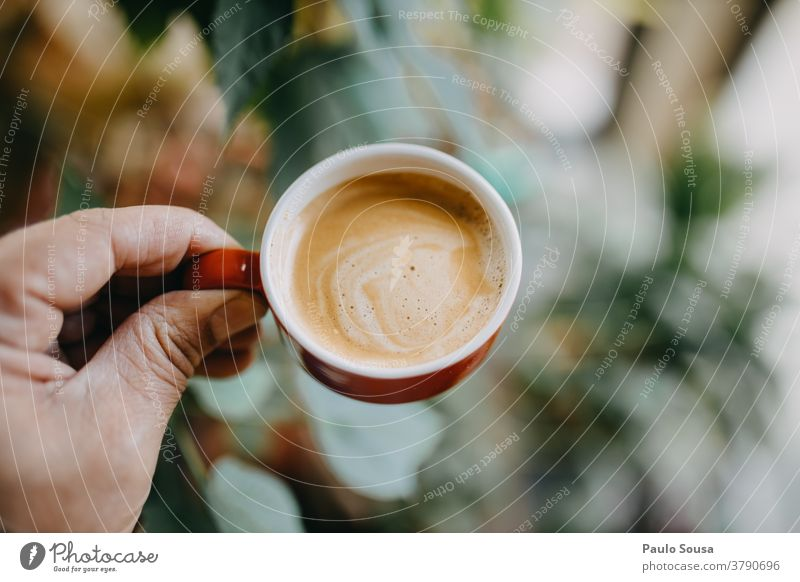 Close up hand holding coffee cup Coffee Coffee break Coffee cup Espresso Table Colour photo Café To have a coffee Breakfast Hot drink Drinking Cup Beverage Food