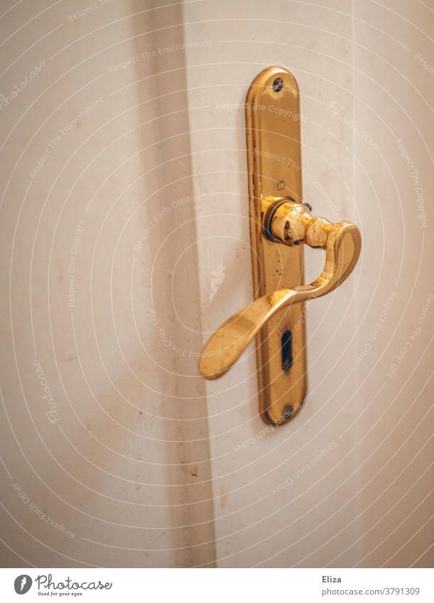 White door with gold door fittings. Door handle and door lock. door handle Door lock golden Old Old building Entrance Keyhole Wooden door