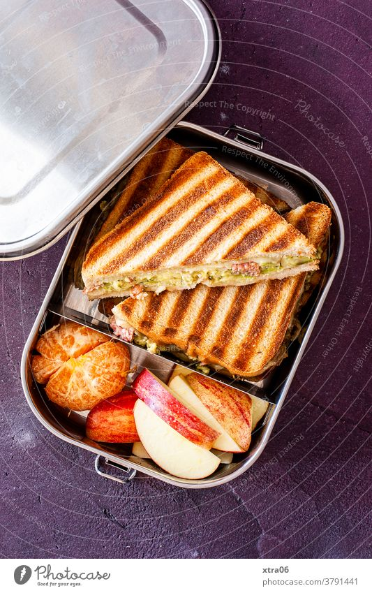 A lunch box / snack box with sandwiches, apple and tangerine. Food photograph lunchbox Lunchtime Snack Box Apple Slice of apple Tangerine Sandwich Nutrition