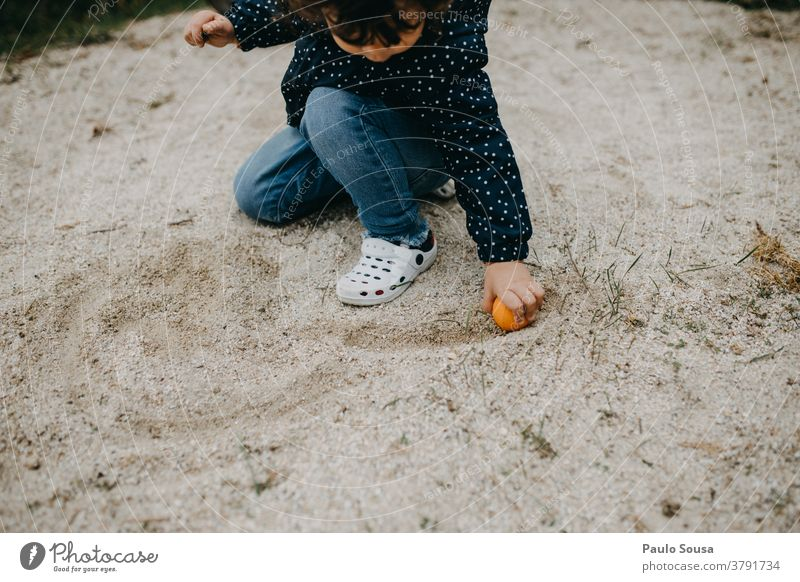 Child playing outdoors with sand Children's game childhood Caucasian Infancy Joy Colour photo Exterior shot Lifestyle Day Toddler Happiness Playing Human being
