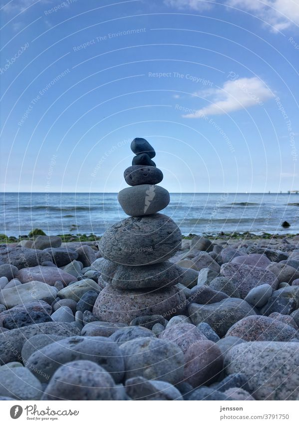 Cairn on the Baltic Sea beach Stone stones Stony Beach Deserted Day Pebble Ocean Gray Gravel beach Structures and shapes Exterior shot Colour photo coast Nature
