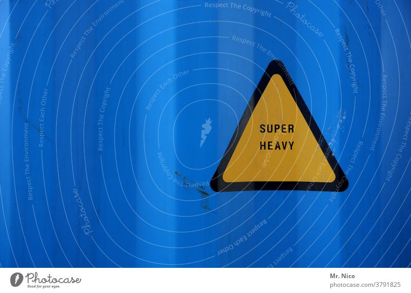 very heavy yellow triangle in front of blue background heavyweight Heavy Signs and labeling Signage Yellow Blue Triangle Warning sign Warning label Container