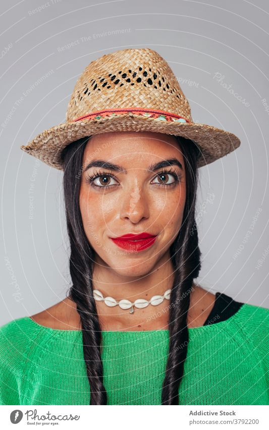 Charming ethnic woman in straw hat style fashion brunette bright portrait outfit charming appearance young necklace hairstyle female authentic red lips