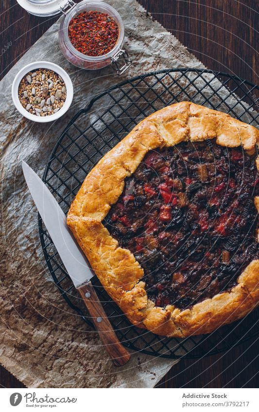 Appetizing vegetable galette on table baked appetizing nutrition food dish tradition kitchen knife fresh homemade natural healthy cuisine meal vitamin