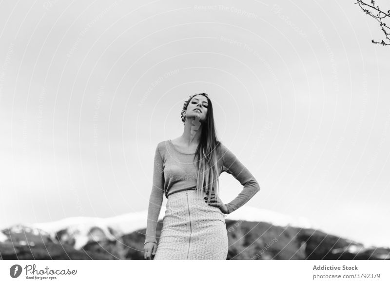 Gorgeous woman standing with arm on waist in nature confident grace style posture appearance hand on waist cool gorgeous tranquil serene elegant feminine trendy