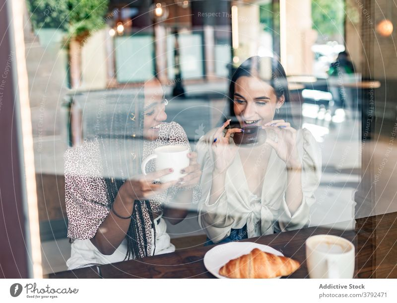 Young stylish women having coffee break in cafe friend meeting happy cheerful together chat style gather enjoy trendy young millennial drink girlfriend
