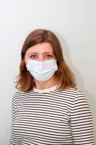 woman wearing an anti-virus protection mask to prevent flu infection, allergies, virus protection, COVID-19, and corona virus pandemic disease 2019 face doctor