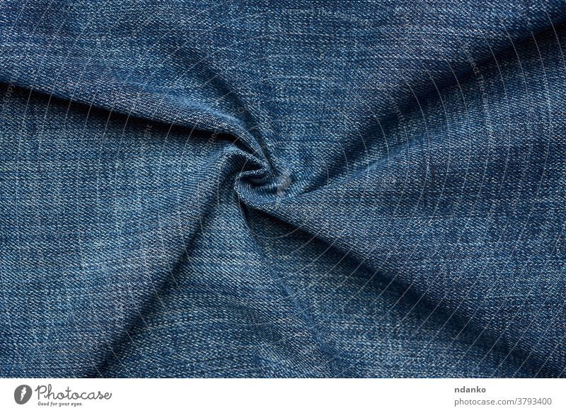 curled blue jeans texture, full frame apparel backdrop background canvas casual closeup cloth clothing color cotton dark denim design detail fabric fashion